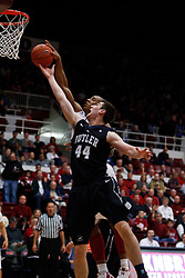 Dec 22, 2011; Stanford CA, USA;  Butler Bulldogs center Andrew Smith (44) and Stanford Cardinal forward/center Josh Owens (back) reach for a rebound during the first half at Maples Pavilion.  Butler defeated Stanford 71-66. Mandatory Credit: Jason O. Watson-US PRESSWIRE