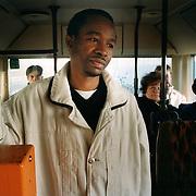 Bus passengers gaze at Nigerian asylum seeker, Obi Ogbonara, in Eberswalde in eastern Germany...Picture taken autumn 2000 by Justin Jin. (c) 2000 by Justin Jin.