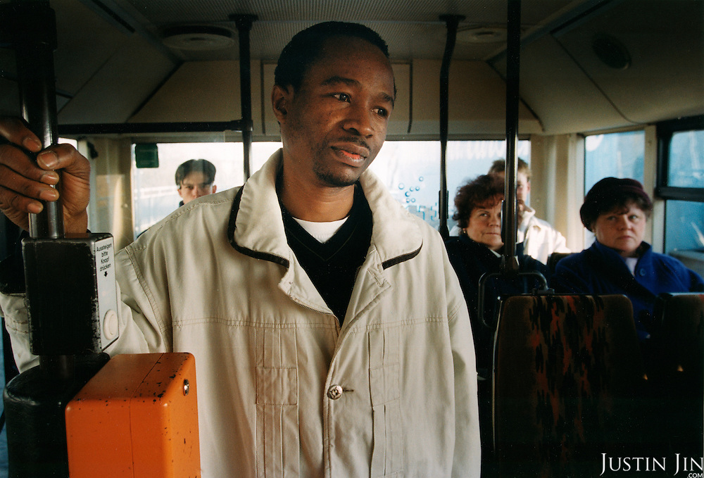 Bus passengers gaze at Nigerian asylum seeker, Obi Ogbonara, in Eberswalde in eastern Germany...Picture taken autumn 2000 by Justin Jin. (c) 2000 by Justin Jin.