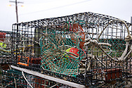April 27, 2011 - A lobster trap with line and an identification buoy stored inside in Sandwich, MA.
