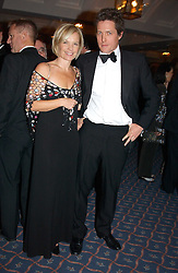 Actor HUGH GRANT and MARIELLA FROSTRUP at the 2004 Whitbread Book Awards held at The Brewery, Chiswell Street, London EC1 on 25th January 2005.<br /><br /><br />NON EXCLUSIVE - WORLD RIGHTS