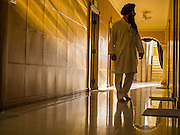 "08 FEBRUARY 2015  BANGKOK, THAILAND: A Sikh man walks between rooms used for the study of Sikh texts in Gurdwara Siri Guru Singh Sabha, the Sikh temple in Bangkok. Thailand has a small but influential Sikh community. Sikhs started coming to Thailand, then Siam, in the 1890s. There are now several thousand Thai-Indian Sikh families. Gurdwara Siri Guru Singh Sabha was established in 1913. Construction of the current building, adjacent to the original Gurdwara (""Gateway to the Guru""), started in 1979 and was finished in 1981. The Sikh community serves a daily free vegetarian meal at the Gurdwara that is available to people of any faith and background.    PHOTO BY JACK KURTZ"