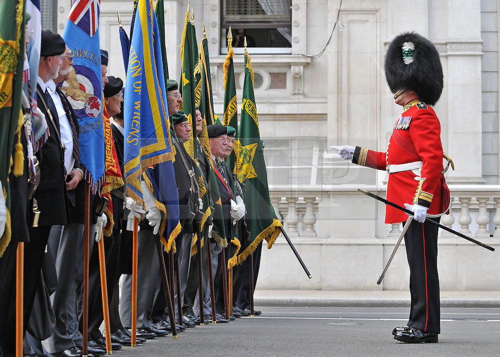 LONDON. UK. Sgt Major Billy Mott MBE explains to the VJ Veterans the procedure for the day. The Prime Minister, HRH Prince Charles and Duchess of Cornwall attend the 65th Anniversary of Japan's WWII surrender. Today marks VJ day, the anniversary of Japan's surrender to allied forces and the end of the Second World War in 1945. The Allies had delivered Japan an ultimatum to surrender on 28 July 1945. However, this was ignored and the US then dropped atomic bombs on Hiroshima on 6 August and on Nagasaki on 9 August. While 15 August is celebrated as the day of the surrender, the Japanese administration under General Koiso Kuniaki officially did not deliver the signed surrender document until 2 September, which is also known as VJ Day.15 August 2010. STEPHEN SIMPSON..