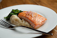 Salmon Filet with Whipped Potatoes and Braised Greens at Coastal Bistro in St. Louis.