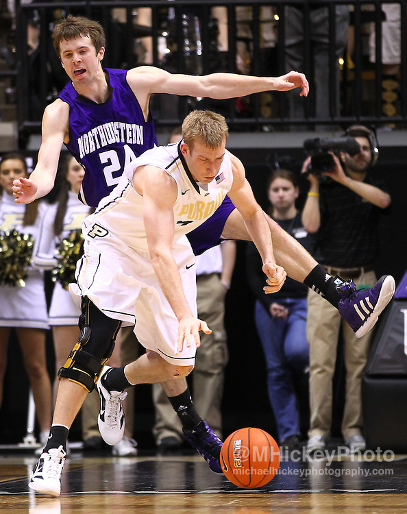 Feb. 12, 2012; West Lafayette, IN, USA; Purdue Boilermakers forward Robbie Hummel (4) loses control of the ball as Northwestern Wildcats forward John Shurna (24) defends from behind at Mackey Arena. Purdue defeated Northwestern 87-77. Mandatory credit: Michael Hickey-US PRESSWIRE