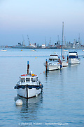 Gosport, Hants UK - Dec 25 2014: Three boats in a line, moored in Gosport and Portsmouth harbour on 25 Dec in Gosport, UK
