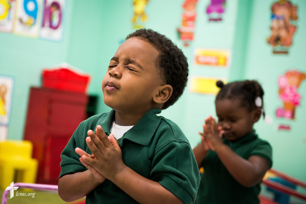 Preschoolers LaTerry Kennedy and Angelina McKenzie pray during school at Trinity Evangelical Lutheran School on Monday, April 7, 2014, in Mobile, Ala. LCMS Communications/Erik M. Lunsford