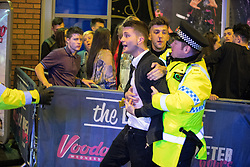 "© Licensed to London News Pictures . 17/12/2016 . Manchester , UK . Police intervene to prevent a fight from escalating , outside The Birdcage on Withy Grove . Revellers out in Manchester City Centre overnight during "" Mad Friday "" , named for being one of the busiest nights of the year for the emergency services in the UK . Photo credit : Joel Goodman/LNP"