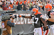 Cleveland receiver Braylon Edwards,left, celebrates with linemen Joe Thomas, Rex Hadnot and Kevin Shaffer after Edwards' 28-yard TD pass in the third quarter..