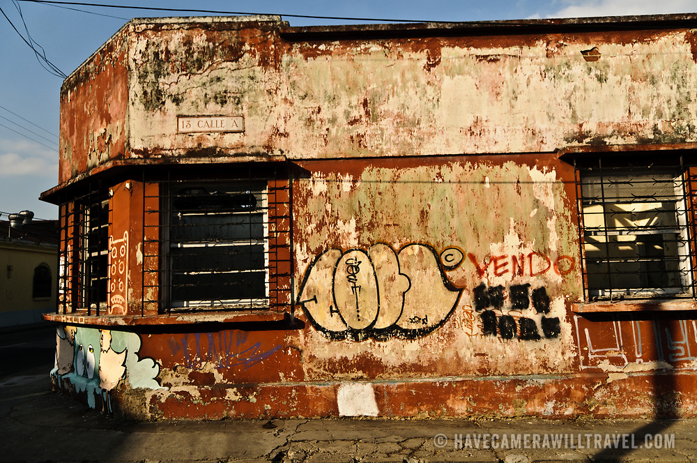 An abandoned building with graffiti in downtown Guatemala City