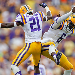 Oct 12, 2013; Baton Rouge, LA, USA; LSU Tigers defensive back Rashard Robinson (21) and safety Craig Loston (6) celebrate after a turnover against the Florida Gators during the fourth quarter of a game at Tiger Stadium. LSU defeated Florida 17-6. Mandatory Credit: Derick E. Hingle-USA TODAY Sports