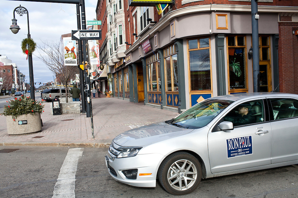 A car driving through downtown has a sign supporting Republican presidential candidate Ron Paul on Sunday, January 8, 2012 in Manchester, NH. Brendan Hoffman for the New York Times
