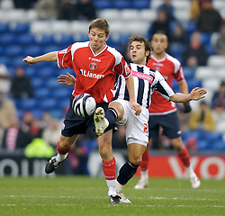 WEST BROMWICH, ENGLAND - Saturday, December 15, 2007: Charlton's Matthew Holland in action against West Bromwich Albion's captan Jonathan Greening during the League Championship match at the Hawthorns. (Photo by David Rawcliffe/Propaganda)