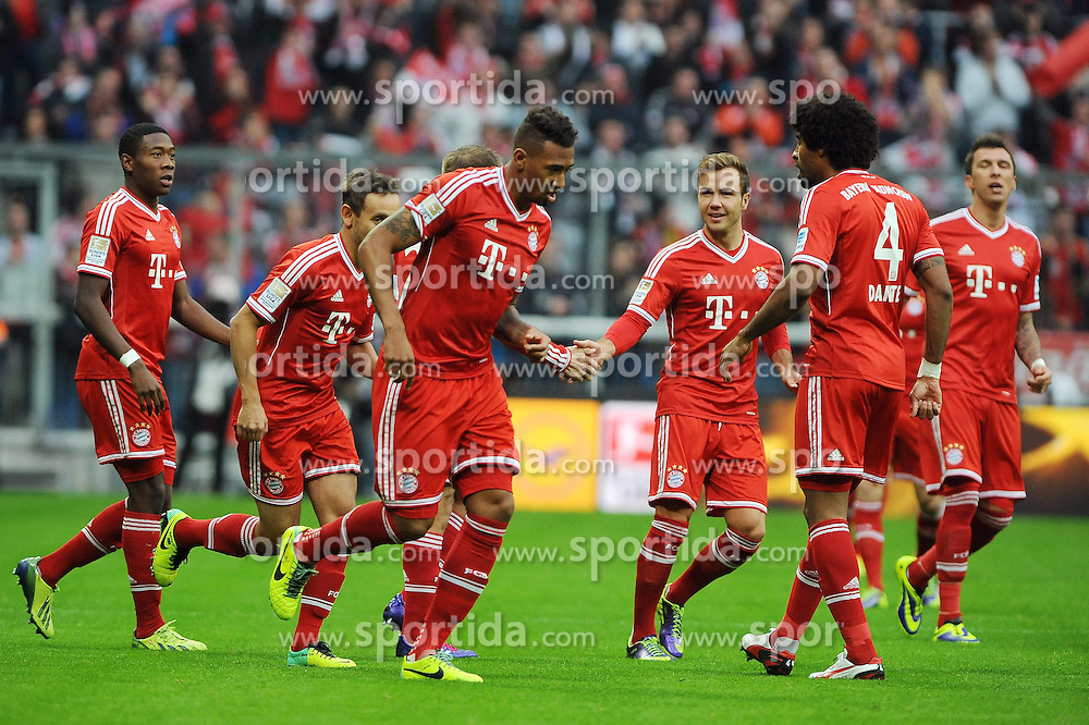 09.11.2013, Allianz Arena, Muenchen, GER, 1. FBL, FC Bayern Muenchen vs FC Augsburg, 12. Runde, im Bild Jerome Boateng (FC Bayern Muenchen) klatscht Mario Goetze (FC Bayern Muenchen) ab, nach seinem Tor zum 1:0 // during the German Bundesliga 12th round match between FC Bayern Munich and FC Augsburg at the Allianz Arena in Muenchen, Germany on 2013/11/09. EXPA Pictures &copy; 2013, PhotoCredit: EXPA/ Eibner-Pressefoto/ Stuetzle<br /> <br /> *****ATTENTION - OUT of GER*****