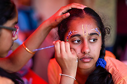 © Licensed to London News Pictures. 23/08/2019. LONDON, UK.  A devotee has gopi dots facepaint applied as thousands celebrate the birth of Lord Krishna at the Janmashtami festival at the Bhaktivedanta Manor Hare Krishna Temple in Watford, Hertfordshire.  The manor was donated to the Hare Krishna movement by ex Beatle George Harrison and annually hosts the biggest Janmashtami festival outside of India. (Parental permission obtained).  Photo credit: Stephen Chung/LNP