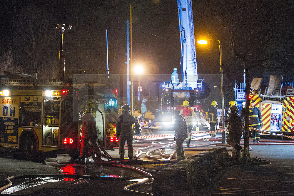 © Licensed to London News Pictures . 13/03/2013 . Alderley Edge , Cheshire , UK . Several fire units at the rear of the venue . Famous celebrity nightclub , Panacea , in Alderley Edge , is ablaze tonight (12th March) . Fire crews and police were initially called to the venue at 22:30 on Tuesday night (12th March) . Around 50 fire-fighters from Cheshire and Greater Manchester worked to control the fire at the venue , which is adjacent to a petrol station and residential properties in the affluent village of Alderley Edge . This is the second time in five years the venue has been destroyed by fire , previously following a £3.2 million refurbishment in September 2008 . Photo credit : Joel Goodman/LNP