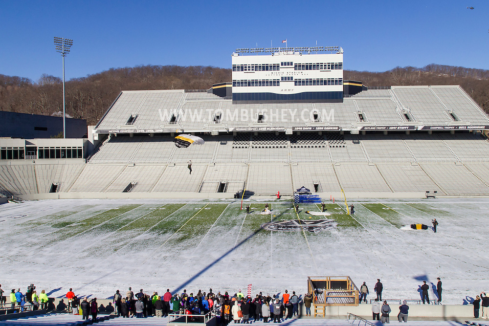 West Point, New York - A member of the West Point Parachute Team glides into Michie Stadium before the West Point Half-Marathon Fallen Comrades Run at the United States Military Academy on March 29, 2015.