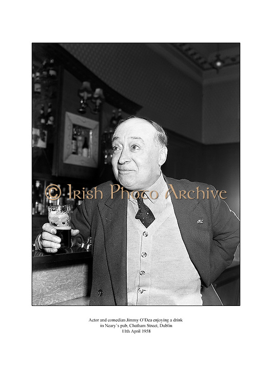 Actor and comedian Jimmy O'Dea enjoying a drink in Neary's pub, Chatham Street, Dublin.<br />