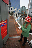 Girl mails letter in world's largest mailbox (Guinness World Records) in downtown Vancouver, British Columbia, Canada.