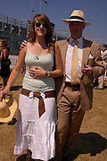 Daisy Fane and her father the Earl of Westmorland. Veuve Clicquot Gold Cup Final at Cowdray Park. Midhurst. 17 July 2005. ONE TIME USE ONLY - DO NOT ARCHIVE  © Copyright Photograph by Dafydd Jones 66 Stockwell Park Rd. London SW9 0DA Tel 020 7733 0108 www.dafjones.com