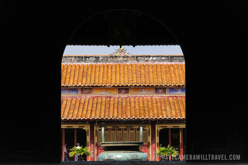 The shadows of another building frame the To Mieu Temple at the Imperial City in Hue, Vietnam. A self-enclosed and fortified palace, the complex includes the Purple Forbidden City, which was the inner sanctum of the imperial household, as well as temples, courtyards, gardens, and other buildings. Much of the Imperial City was damaged or destroyed during the Vietnam War. It is now designated as a UNESCO World Heritage site.