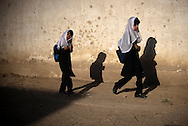 School girls make their way along the street in Kabul, Afghanistan August 13, 2009. 41 candidates are due to run in Afghanistan's presidential elections which are to be held on August 20. The incumbent president Karzai is considered to be the frontrunner despite claims of corruption and what many consider an ineffectual government.