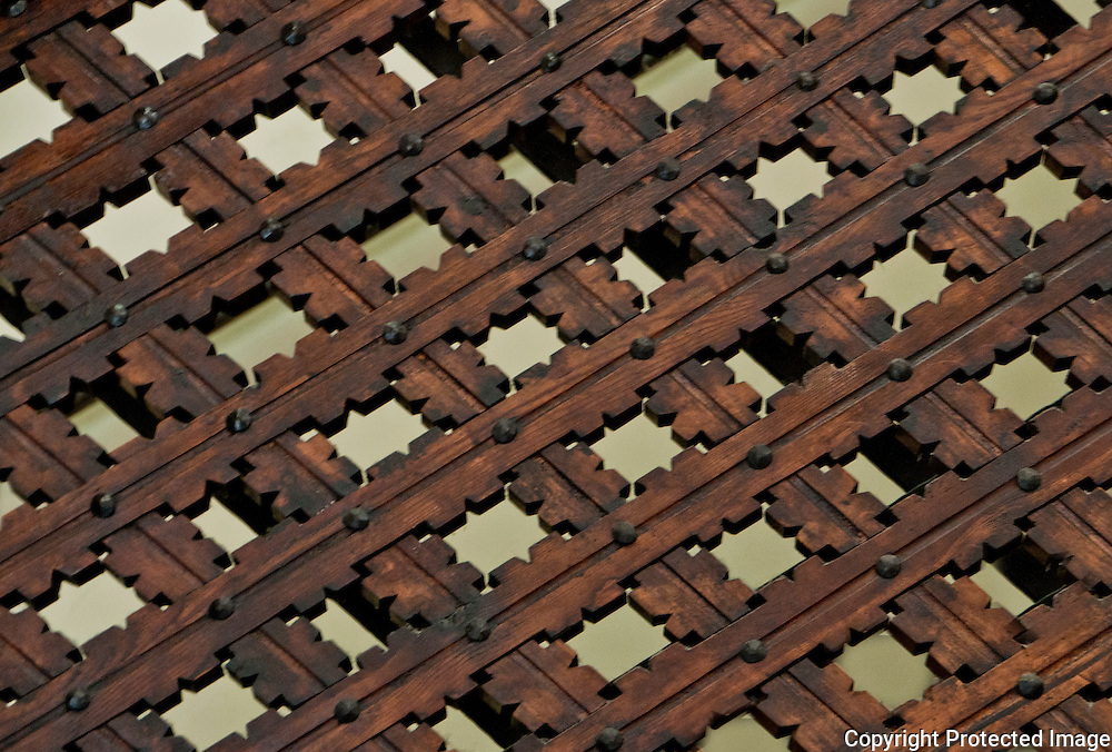 Close-up of a beautifully carved wooden fretwork pattern seen in a palazzo in Venice, Italy.