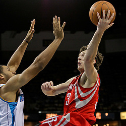 April 19, 2012; New Orleans, LA, USA; Houston Rockets point guard Goran Dragic (3) shoots over Houston Rockets power forward Luis Scola (4) during the second half at the New Orleans Arena. The Hornets defeated the Rockets 105-99.   Mandatory Credit: Derick E. Hingle-US PRESSWIRE