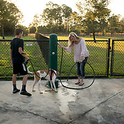 ROYAL PALM BEACH, FLORIDA, MARCH 15, 2017<br /> Cynthia Greaux  and her children; Tyler, 14, and Chloe, 8, clean up the feet of their recently adopted dog &quot;Ginger&quot; after playing in the dog park a short walk from their house. Greaux is able to use vouchers to pay for their enrollment at a private school that specializes in educating children with dyslexia.<br /> (Photo by Angel Valentin/Freelance)