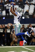 Dallas Cowboys strong safety Barry Church (42) leaps and catches a pregame pass before the NFL week 18 NFC Wild Card postseason football game against the Detroit Lions on Sunday, Jan. 4, 2015 in Arlington, Texas. The Cowboys won the game 24-20. ©Paul Anthony Spinelli