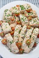 Salmon fillet seasoned with cherry tomato