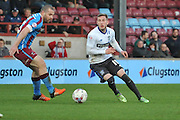 Danny Mayor (10) of Bury and Stephen Dawson of Scunthorpe United during the Sky Bet League 1 match between Scunthorpe United and Bury at Glanford Park, Scunthorpe, England on 19 April 2016. Photo by Ian Lyall.