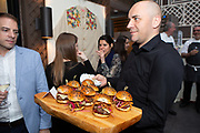 New York, NY - April 17, 2018: The Blended Burger Bun'anza, presented by The James Beard Foundation and The Mushroom Council host the winning chefs from campus dining programs at colleges and universities around the country. <br /> CREDIT: Clay Williams for The James Beard Foundation.<br /> <br /> &copy; Clay Williams / http://claywilliamsphoto.com