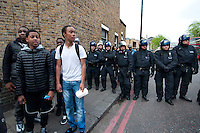 Group of lads in Brixton with riot Police called in to Brixton following reclaim Brixton event