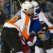 April 20, 2014:  Philadelphia Flyers left wing Scott Hartnell (19) bends New York Rangers center Dominic Moore (28) in half during game two of the first round playoff game between The New York Rangers and The Philadelphia Flyers at  Madison Square Garden in Manhattan, New York . (Credit Image: © Kostas Lymperopoulos/Cal Sport Media)