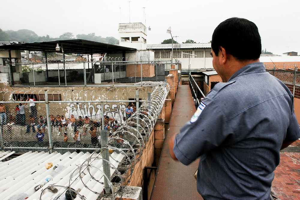 The director of security looks down on a sector of prisoners at the Cojutepecque prison outside of San Salvador.  Within the sectors themselves there is little security and fights are common.