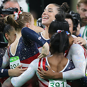 Gymnastics - Olympics: Day 4   Alexandra Raisman, (facing), of the United States celebrates with team mates Madison Kocian, Lauren Hernandez, Gabrielle Douglas and Simone Biles after the United States team won the Artistic Gymnastics Women's Team Final at the Rio Olympic Arena on August 9, 2016 in Rio de Janeiro, Brazil. (Photo by Tim Clayton/Corbis via Getty Images)