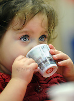 1 year old Sophia Morgan drinks from her cup at the Parent/child Valentine tea party with tea and cakes that included the children singing and performing for their parents at the ADVOCAP Head Start office in downtown Fond du Lac. Tuesday, February 14, 2012. The Reporter photo by Patrick Flood.