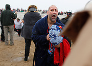Ed Porto climbs out of Lake Ontario at the 14th Annual Polar Bear Plunge at Ontario Beach Park on Sunday, February 9, 2014.