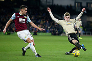 Manchester United defender Brandon Williams (53) blocks Burnley midfielder Ashley Westwood (18) during the Premier League match between Burnley and Manchester United at Turf Moor, Burnley, England on 28 December 2019.