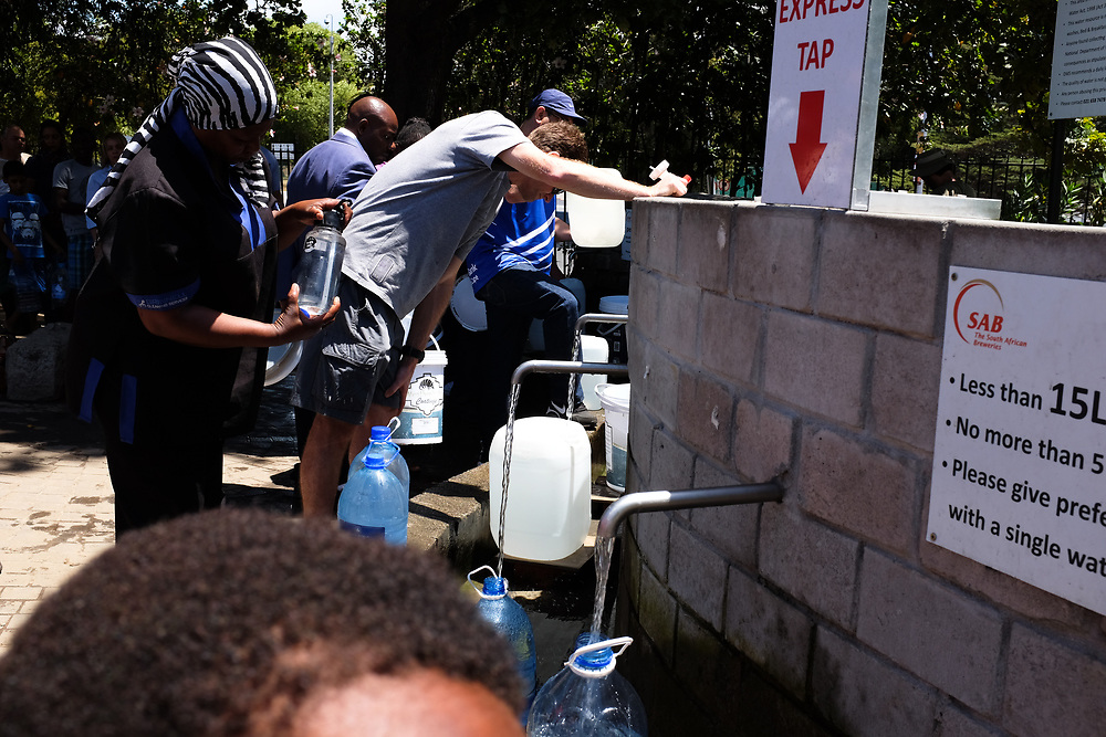 Signs direct people collecting water at Josephine's Mill Spring, Newlands. Water is collected to offset the 50L a day limit for household use and to offset the cost of municipal water. January 2018.
