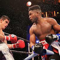 WINTER PARK, FL - AUGUST 02: Yudel Jhonson of Havana, Cuba (R) lands a right cross against Jorge Cota of Sinaloa, Mexico during the Premier Boxing Champions on Bounce TV boxing match at Full Sail University - Ebbs Auditorium on August 2, 2015 in Winter Park, Florida. Cota won the bout by unanimous decision. (Photo by Alex Menendez/Getty Images) *** Local Caption *** Yudel Jhonson; Jorge Cota