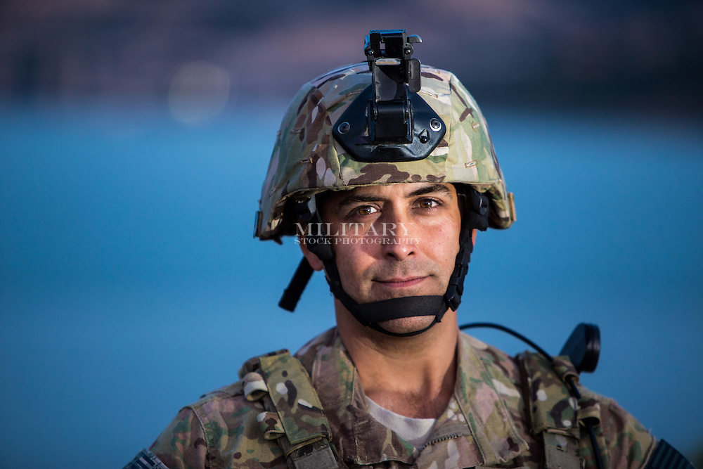 Army soldier daylight portraits in and around a strategic waterway.  If radio in photo, it is a Harris AN/PRC-117F with satcom antenna system.  Model-released and DoD-compliant with minor visual editing (flags on shoulders and vest)