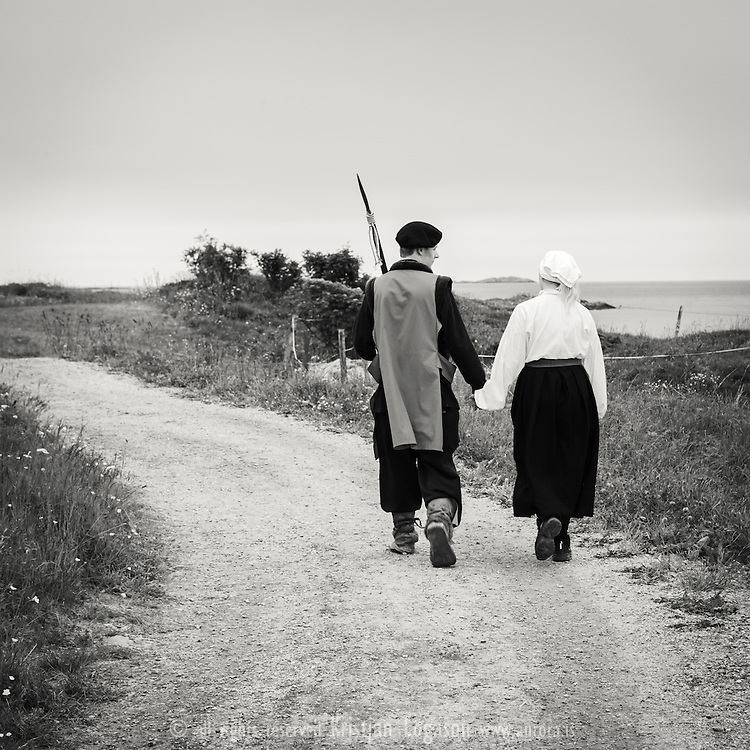 Two young actors from the Kinnaspilet in the Island of Kinn in Flora Norway have a romantic walk in their costumes towards the open space area where the historical performance is held each year since 1985