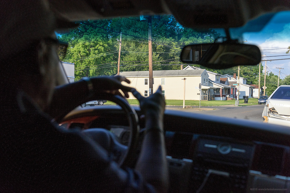 During a Monday, June 20, 2016 ride-along with Eddie Woods, director of Street Peace: No More Red Dots, he points to a corner where a gunfight resulted in his car being struck by bullets. (Photo by Brian Bohannon)