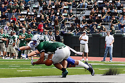 17 September 2011: Joey Driver can't get a hold on a pass to the end zone after Kevin Glock dives in front of him in an attempt to intercept during an NCAA Division 3 football game between the Aurora Spartans and the Illinois Wesleyan Titans on Wilder Field inside Tucci Stadium in.Bloomington Illinois.