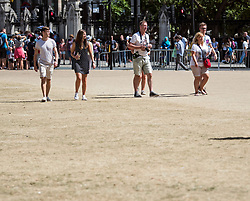 © Licensed to London News Pictures. 06/08/2018. London, UK.  The ground on Parliament Square opposite the Houses of Parliament, which is normally covered in grass, tuned to burnt ground and dirt following an extended period of hot weather rain the capital. Photo credit: Ben Cawthra/LNP