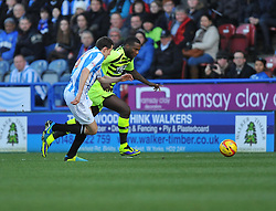 Yeovil Town's Ishmael Miller attacks down the wing under pressure from Huddersfield Town's Murray Wallace - Photo mandatory by-line: Alex James/JMP - Tel: Mobile: 07966 386802 29/12/2013 - SPORT - FOOTBALL - John Smith's Stadium - Huddersfield - Huddersfield Town v Yeovil Town - Sky Bet Championship