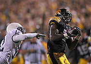 October 2 2010: Iowa Hawkeyes wide receiver Marvin McNutt (7) pulls in a pass as Penn State Nittany Lions cornerback Stephon Morris (12) defends during the first half of the NCAA football game between the Penn State Nittany Lions and the Iowa Hawkeyes at Kinnick Stadium in Iowa City, Iowa on Saturday October 2, 2010. Iowa defeated Penn State 24-3.