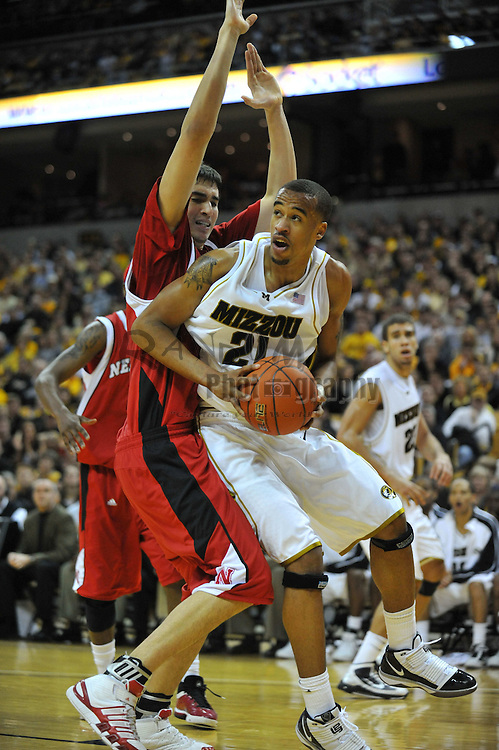 Jan 23, 2010; Columbia, MO, USA; Missouri Tigers forward Laurence Bowers (21) drives the baseline on Nebraska Cornhuskers center Brian Diaz (21) in the second half at Mizzou Arena in Columbia, MO. Missouri won 70-53. Mandatory Credit: Denny Medley-US PRESSWIRE